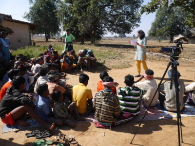 Round 1 community meeting informing a village about the project